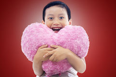Little boy holding heart Stock Photos