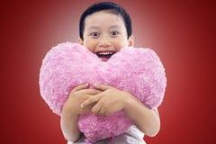 Little boy holding heart Stock Photos