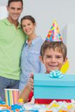 Little boy holding his birthday gift Stock Images