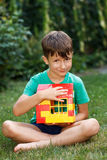 Little boy holding house outdoor Royalty Free Stock Photography