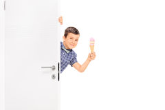 Little boy holding and ice cream behind a door Royalty Free Stock Images