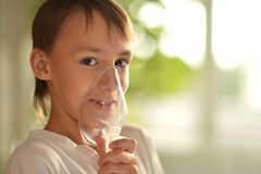 Little boy holding inhaler Stock Photography