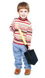 Little boy holding a large Sapper shovel Royalty Free Stock Photography