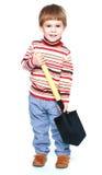 Little boy holding a large Sapper shovel Royalty Free Stock Photography