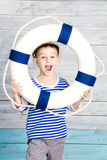 Little boy holding a life preserver and screaming. Closeup Stock Photography