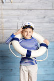 Little boy holding lifebuoy Stock Photos