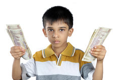 Little Boy Holding the money with Expression Royalty Free Stock Image