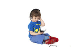 Little boy holding Mp3 player Stock Photography