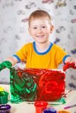 Little boy holding painted picture Royalty Free Stock Photo