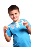 Little boy  holding paper people Stock Photography