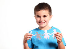 Little boy holding paper people Royalty Free Stock Image