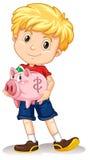 Little boy holding piggy bank Royalty Free Stock Image
