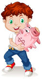 Little boy holding piggy bank Royalty Free Stock Photography