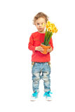 Little boy holding pot of daffodils Stock Photos