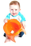 Little boy holding potty Stock Photography