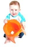 Little boy holding potty. Funny little boy playing with the orange potty studio portrait (on white background stock photography