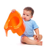 Little boy holding potty Stock Photo