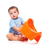 Little boy holding potty Royalty Free Stock Images