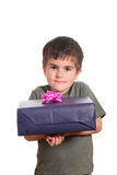 Little boy holding present box Stock Images