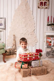 Little boy holding present box in Christmas interior Stock Photography