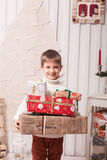 Little boy holding present box in Christmas interior Royalty Free Stock Photography