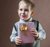 Little boy holding present Stock Images