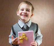 Little boy holding present Royalty Free Stock Photo