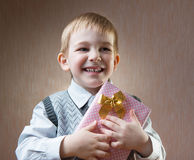 Little boy holding present Royalty Free Stock Image
