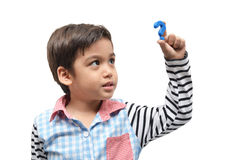 Little boy holding question mark sign Royalty Free Stock Images