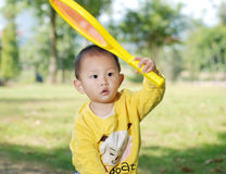 Little boy holding a racquet Stock Photo