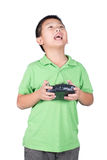 Little boy holding a radio remote control (controlling handset) for helicopter , drone or plane Isolated royalty free stock images