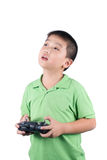 Little boy holding a radio remote control (controlling handset) for helicopter , drone or plane Isolated Royalty Free Stock Image