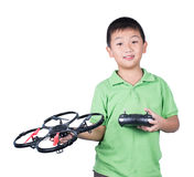 Little boy holding a radio remote control (controlling handset) for helicopter , drone or plane Isolated. On white background Royalty Free Stock Photo