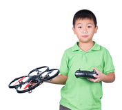 Little boy holding a radio remote control (controlling handset) royalty free stock images