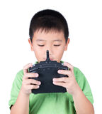 Little boy holding a radio remote control (controlling handset) for helicopter , drone or plane Isolated on white background Stock Image