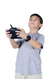 Little boy holding a radio remote control for helicopter, drone royalty free stock images