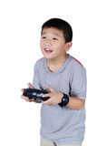 Little boy holding a radio remote control for helicopter, drone stock photo