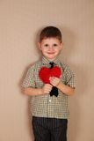 Little Boy Holding a read Heart Stock Image