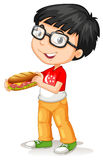 Little boy holding sandwiches Royalty Free Stock Photo