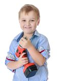 Little boy holding a screwdriver Stock Image