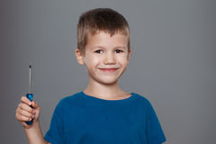 Little boy holding screwdriver Royalty Free Stock Photography