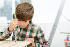 Little boy holding screwdriver Stock Photography