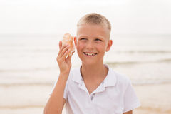 Little boy holding a seashell Royalty Free Stock Photo