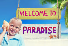 Little Boy Holding a Seashell with Welcome Sign Stock Photo