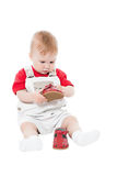 Little boy holding a shoe Stock Photos