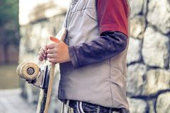 Little boy is holding a skateboard close-up, the concept of a ca royalty free stock photo