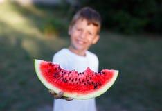 Little boy holding slice of watermelon depth of field Stock Image