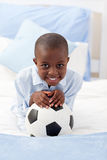 Little boy holding a soccer ball Stock Photography