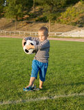 Little boy holding a soccer ball Royalty Free Stock Image
