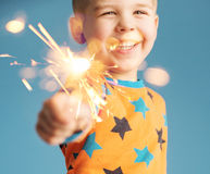 Little boy holding a sparkler Royalty Free Stock Photos